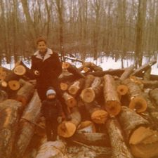 Rod when he was 3.5 years old with his father Willard at a log pile